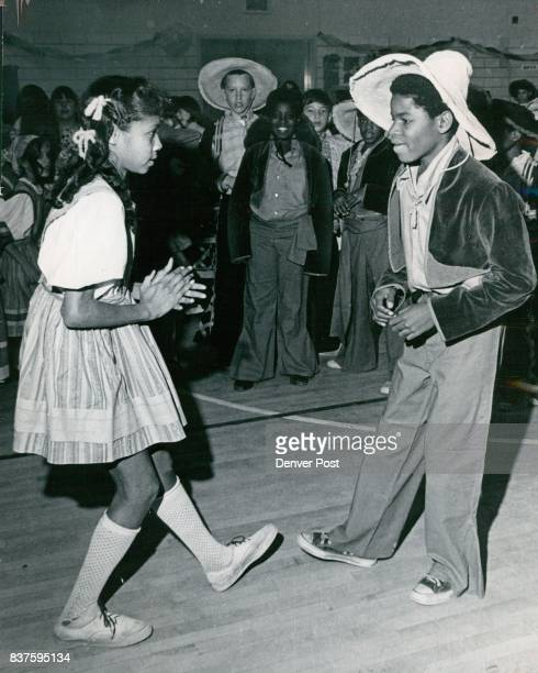 Kimberly Hawkins And Rickey Lee Dance During Barret School Fiesta The sixth graders were stepping to the lively music of the Mexican Hat Dance Credit...