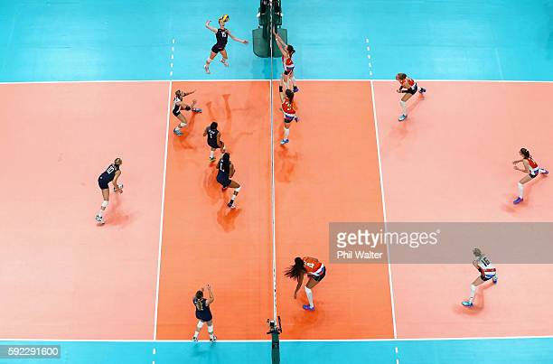 Kimberly Hill of United States spikes the ball during the Women's Bronze Medal Match between Netherlands and the United States on Day 15 of the Rio...