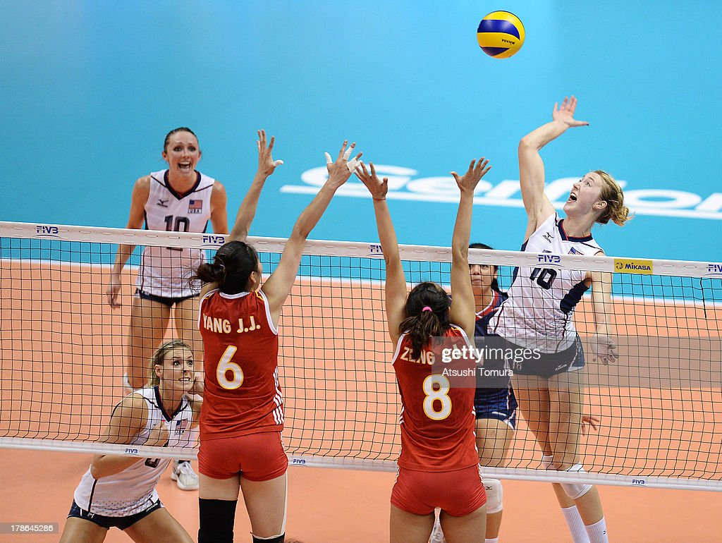 Kimberly Hill of USA spikes the ball during day three of the FIVB World Grand Prix Sapporo 2013 match between China and USA at Hokkaido Prefectural Sports Center on August 30, 2013 in Sapporo, Hokkaido, Japan.