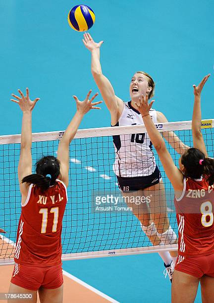 Kimberly Hill of USA spikes the ball during day three of the FIVB World Grand Prix Sapporo 2013 match between China and USA at Hokkaido Prefectural...