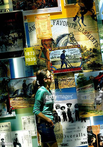 Kimberly Kinard of San Francisco looks at a display of vintage Levi's advertisements at the new Levi Strauss Company Visitor center May 7 2003 in San...