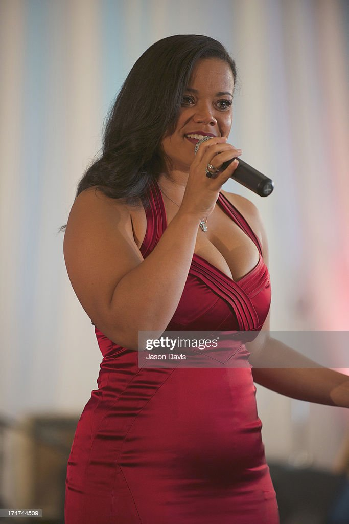 Kimberly Locke attends the Agape Animal Rescue 5th Annual Glitter & Glam gala at the Hutton Hotel on July 28, 2013 in Nashville, Tennessee.