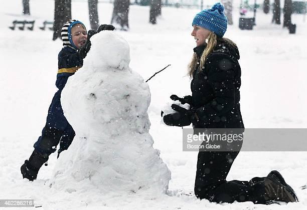 Kimberly McMahon and son Romeo build a snowman on Boston Common Saturday January 24 2015