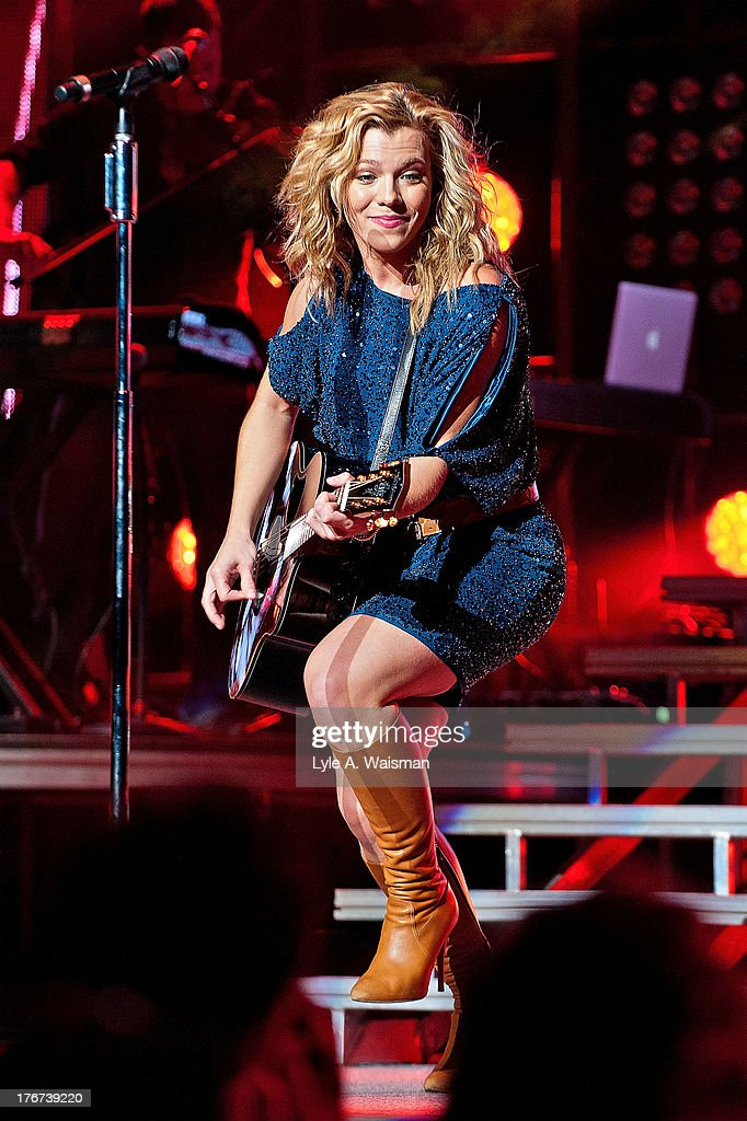 <a gi-track='captionPersonalityLinkClicked' href=/galleries/search?phrase=Kimberly+Perry&family=editorial&specificpeople=6718325 ng-click='$event.stopPropagation()'>Kimberly Perry</a> of the American country music group The Band Perry performs at First Midwest Bank Amphitheatre on August 17, 2013 in Tinley Park, Illinois.