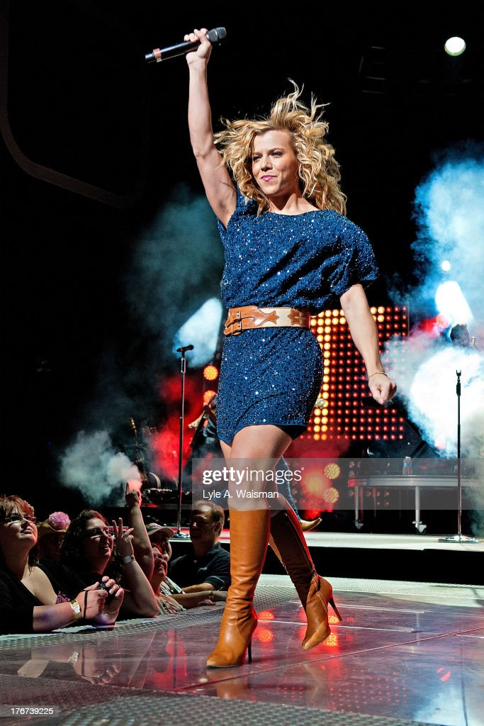 Kimberly Perry of the American country music group The Band Perry performs at First Midwest Bank Amphitheatre on August 17, 2013 in Tinley Park, Illinois.