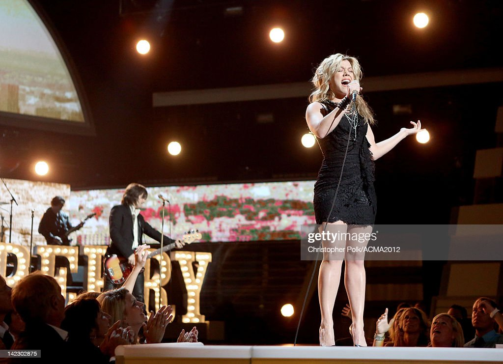 <a gi-track='captionPersonalityLinkClicked' href=/galleries/search?phrase=Kimberly+Perry&family=editorial&specificpeople=6718325 ng-click='$event.stopPropagation()'>Kimberly Perry</a> of The Band Perry performs onstage at the 47th Annual Academy Of Country Music Awards held at the MGM Grand Garden Arena on April 1, 2012 in Las Vegas, Nevada.