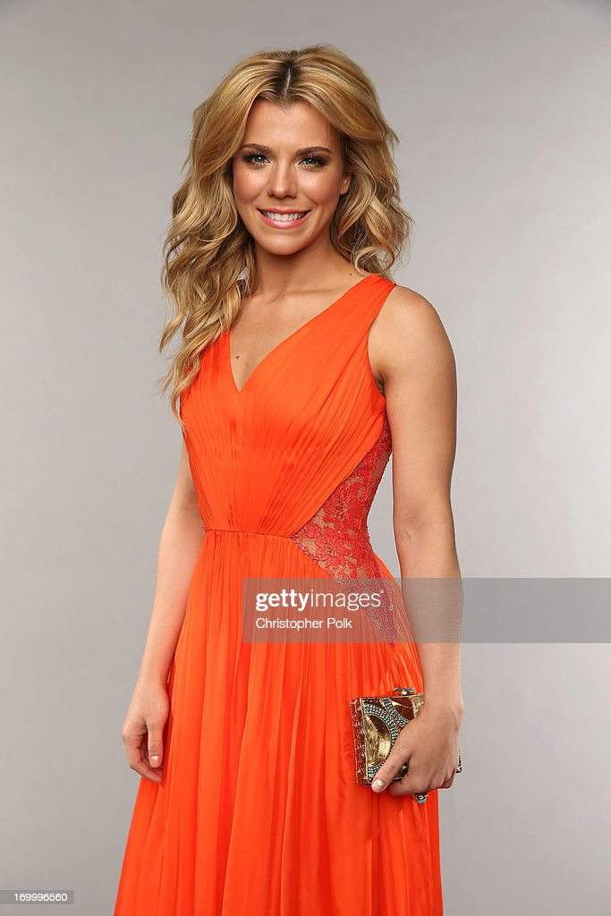 Kimberly Perry of The Band Perry poses at the Wonderwall portrait studio during the 2013 CMT Music Awards at Bridgestone Arena on June 5, 2013 in Nashville, Tennessee.