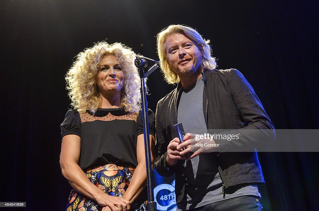 Kimberly Schlapman and Phillip Sweet speak during the 48th Annual CMA Awards Nominees Announcement at Best Buy Theater on September 3, 2014 in New York City.