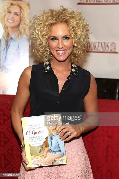 Kimberly Schlapman of Little Big Town and Kimberly's Southern Kitchen show signs copies of her new cookbook 'Oh Gussie' at Bookends Bookstore on...