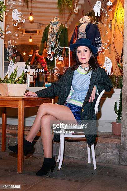 Kimera poses wearing DR Bloom blue hat coat sweater shorts and Blow@Born vintage shoes at the Born District on October 24 2015 in Barcelona Spain