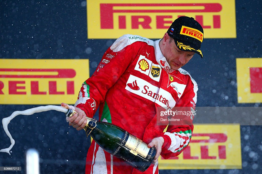Kimi Raikkonen of Finland and Ferrari celebrates on the podium after finishing third in the Formula One Grand Prix of Russia at Sochi Autodrom on May 1, 2016 in Sochi, Russia.