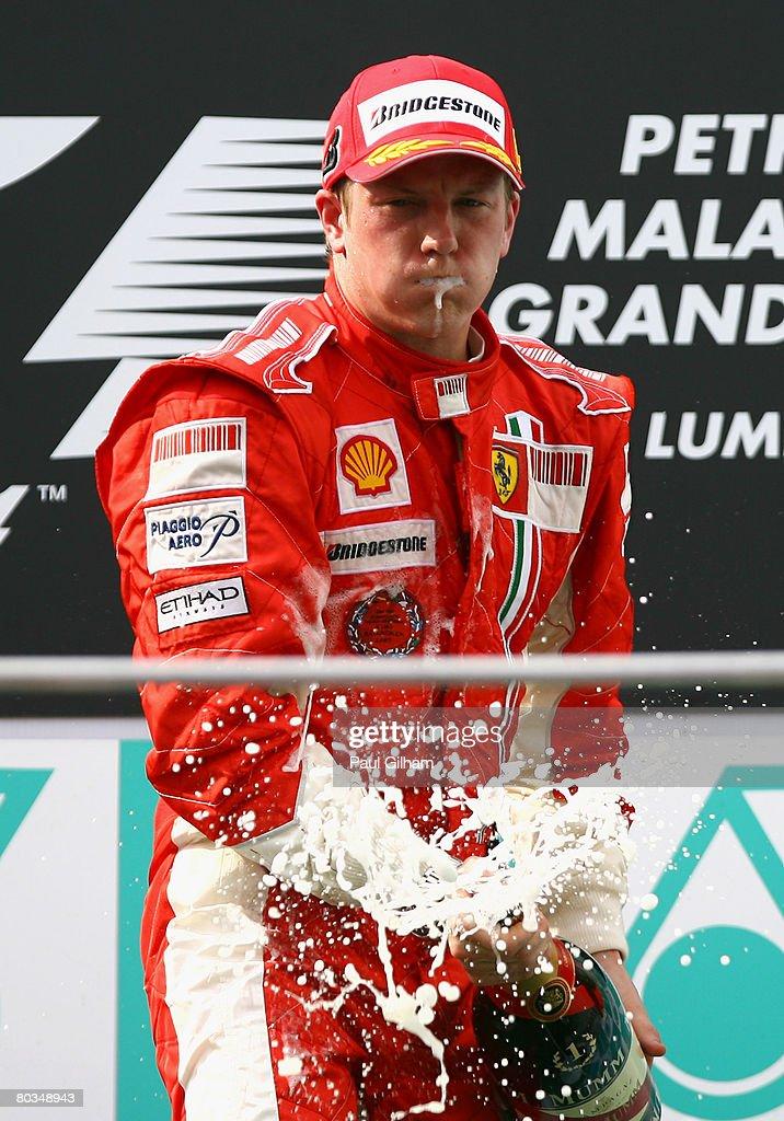 Kimi Raikkonen of Finland and Ferrari celebrates on the podium after winning the Malaysian Formula One Grand Prix at the Sepang Circuit on March 23, 2008 in Kuala Lumpur, Malaysia.