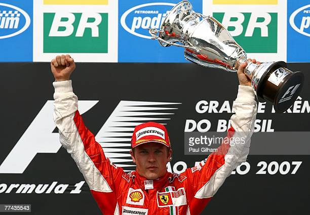 Kimi Raikkonen of Finland and Ferrari celebrates with the trophy on the podium after winning the race and the F1 World Championship at the Brazilian...
