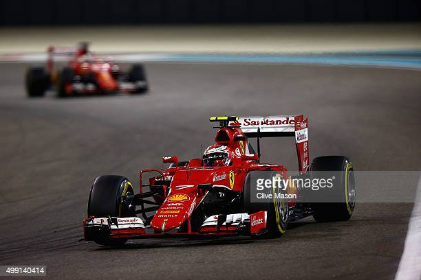 Kimi Raikkonen of Finland and Ferrari drives ahead of Sebastian Vettel of Germany and Ferrari during the Abu Dhabi Formula One Grand Prix at Yas...