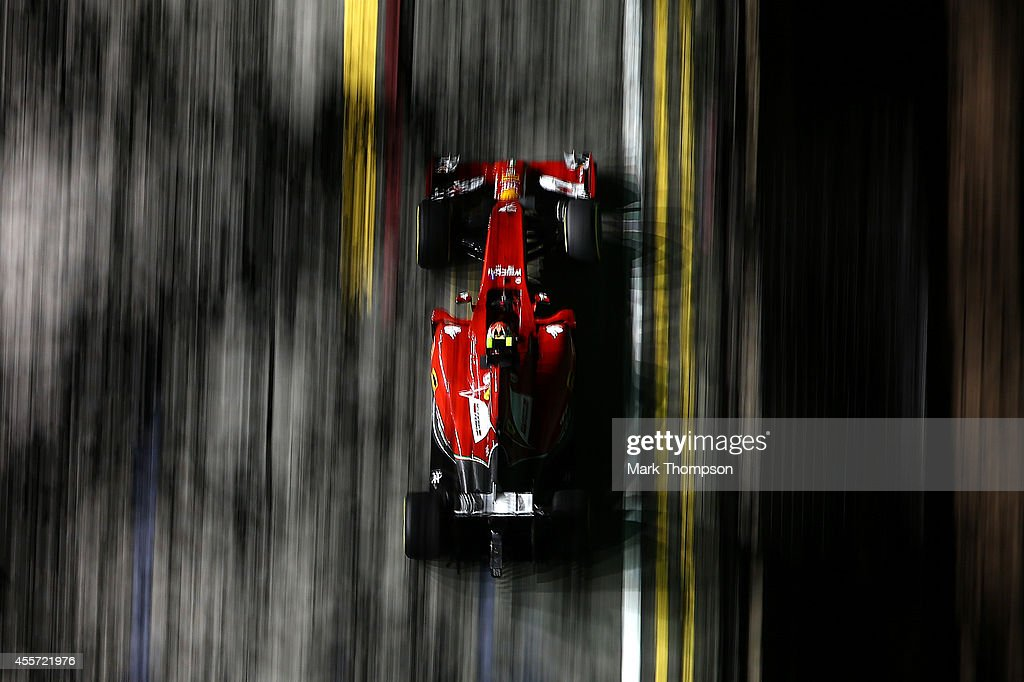Kimi Raikkonen of Finland and Ferrari drives during practice ahead of the Singapore Formula One Grand Prix at Marina Bay Street Circuit on September 19, 2014 in Singapore, Singapore.