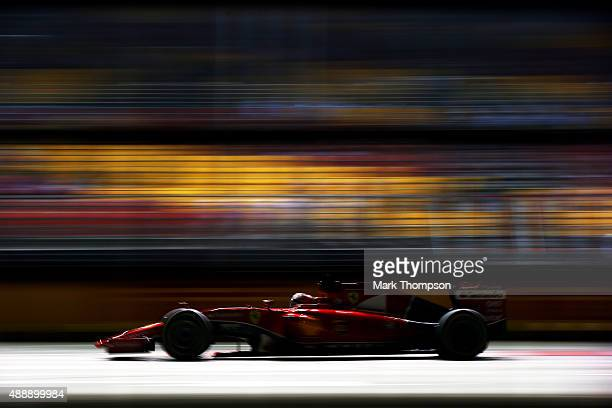 Kimi Raikkonen of Finland and Ferrari drives during practice for the Formula One Grand Prix of Singapore at Marina Bay Street Circuit on September 18...