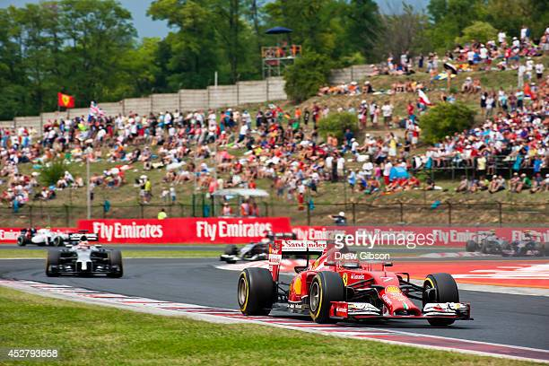 Kimi Raikkonen of Finland and Ferrari drives during the Hungarian Formula One Grand Prix at Hungaroring on July 27 2014 in Budapest Hungary