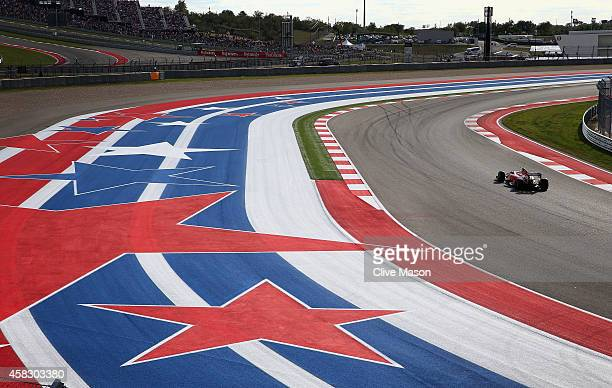 Kimi Raikkonen of Finland and Ferrari drives during the United States Formula One Grand Prix at Circuit of The Americas on November 2 2014 in Austin...