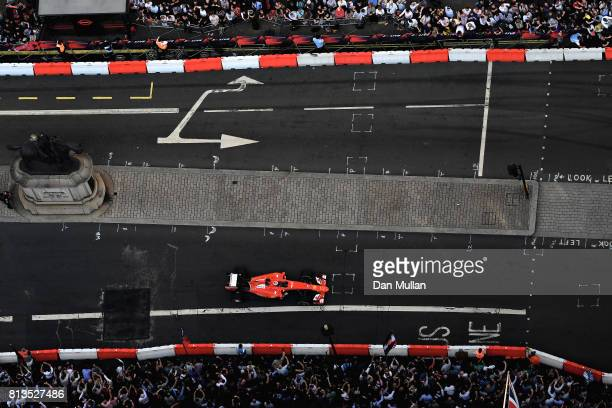 Kimi Raikkonen of Finland and Ferrari driving the Ferrari SF15T during F1 Live London at Trafalgar Square on July 12 2017 in London England F1 Live...