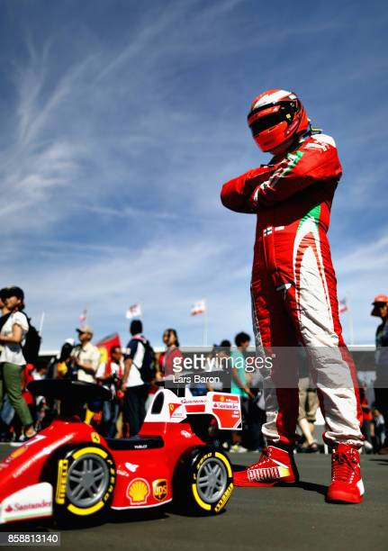 Kimi Raikkonen of Finland and Ferrari fan shows their support before the Formula One Grand Prix of Japan at Suzuka Circuit on October 8 2017 in Suzuka