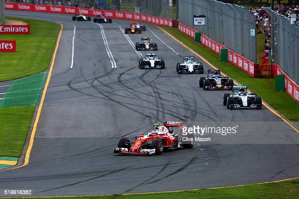 Kimi Raikkonen of Finland and Ferrari leads Nico Rosberg of Germany and Mercedes GP Max Verstappen of Netherlands and Scuderia Toro Rosso Felipe...
