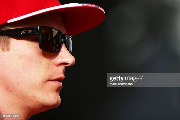 Kimi Raikkonen of Finland and Ferrari looks on during previews to the Bahrain Formula One Grand Prix at Bahrain International Circuit on April 16...
