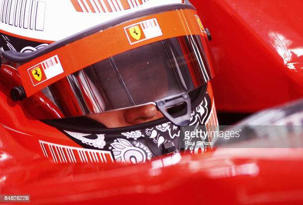Kimi Raikkonen of Finland and Ferrari looks on in his cockpit during Formula One testing ahead of the 2009 Formula One season at the Bahrain...