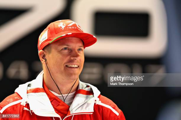 Kimi Raikkonen of Finland and Ferrari looks on in the garage during final practice for the Formula One Grand Prix of Italy at Autodromo di Monza on...