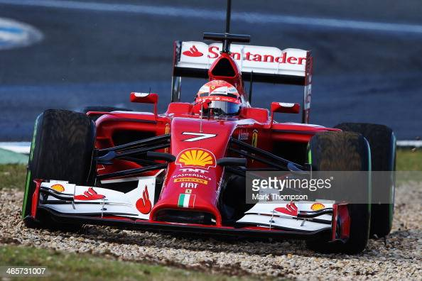 Kimi Raikkonen of Finland and Ferrari misses the chicane and skips across a gravel trap during day two of Formula One Winter Testing at the Circuito...