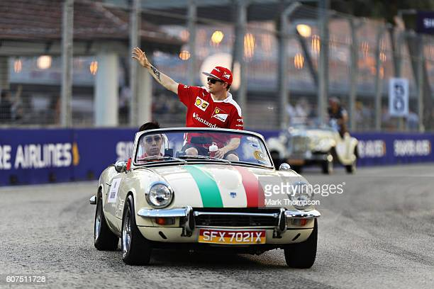 Kimi Raikkonen of Finland and Ferrari on the drivers parade before the Formula One Grand Prix of Singapore at Marina Bay Street Circuit on September...