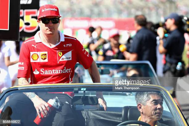 Kimi Raikkonen of Finland and Ferrari on the drivers parade before the Formula One Grand Prix of Japan at Suzuka Circuit on October 8 2017 in Suzuka