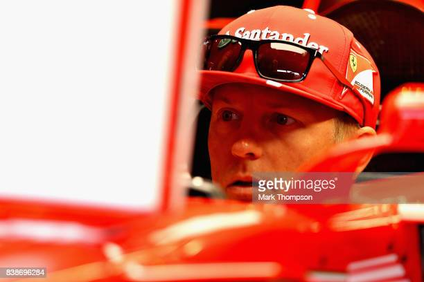 Kimi Raikkonen of Finland and Ferrari prepares to drive in the garage before practice for the Formula One Grand Prix of Belgium at Circuit de...