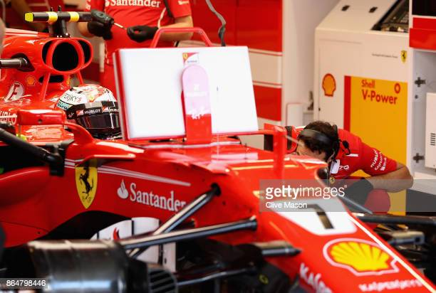 Kimi Raikkonen of Finland and Ferrari prepares to drive in the garage during final practice for the United States Formula One Grand Prix at Circuit...