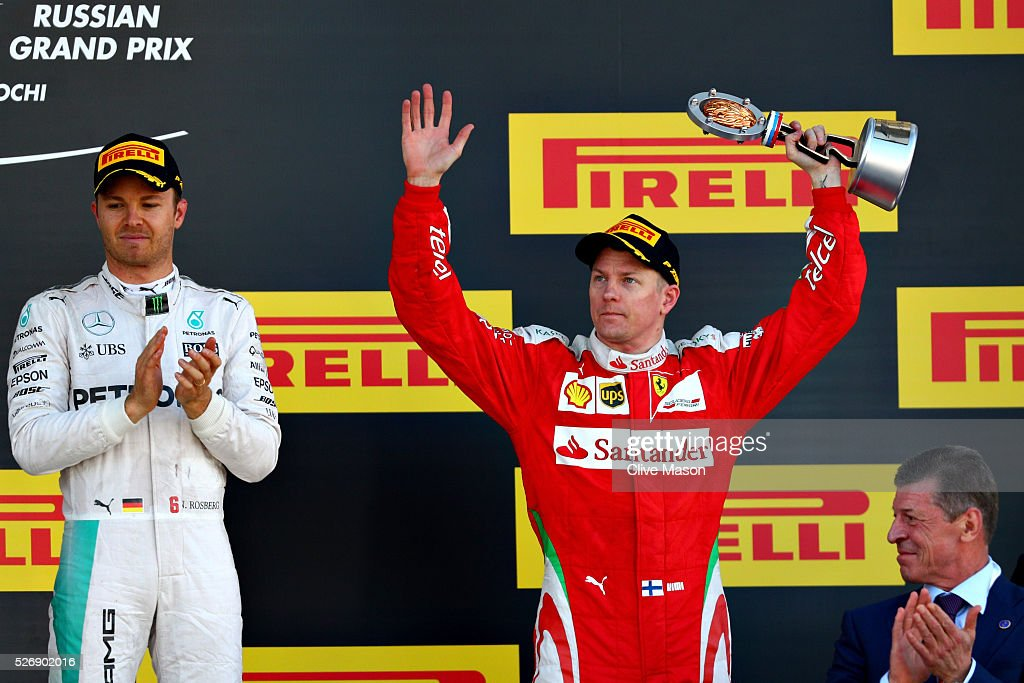 <a gi-track='captionPersonalityLinkClicked' href=/galleries/search?phrase=Kimi+Raikkonen&family=editorial&specificpeople=201904 ng-click='$event.stopPropagation()'>Kimi Raikkonen</a> of Finland and Ferrari raises his trophy for finishing in third place on the podium. <a gi-track='captionPersonalityLinkClicked' href=/galleries/search?phrase=Nico+Rosberg&family=editorial&specificpeople=800808 ng-click='$event.stopPropagation()'>Nico Rosberg</a> of Germany and Mercedes GP and Russian Deputy Prime Minister Dmitry Kozak applaud during the Formula One Grand Prix of Russia at Sochi Autodrom on May 1, 2016 in Sochi, Russia.