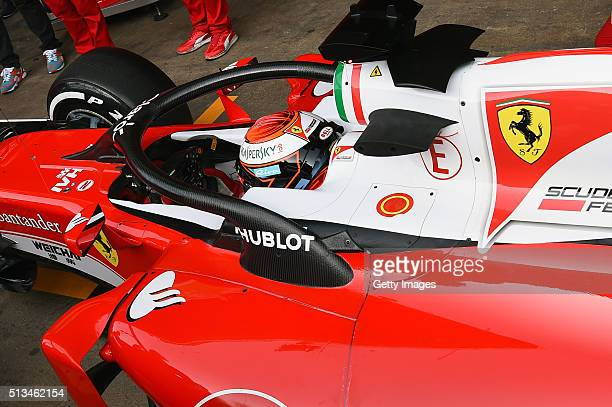 Kimi Raikkonen of Finland and Ferrari returns to the garage after testing the new halo head protection system during day three of F1 winter testing...