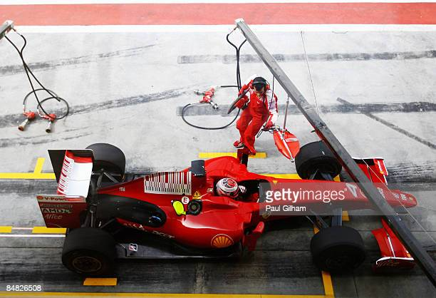 Kimi Raikkonen of Finland and Ferrari waits in his car outside the team garage during Formula One testing ahead of the 2009 Formula One season at the...