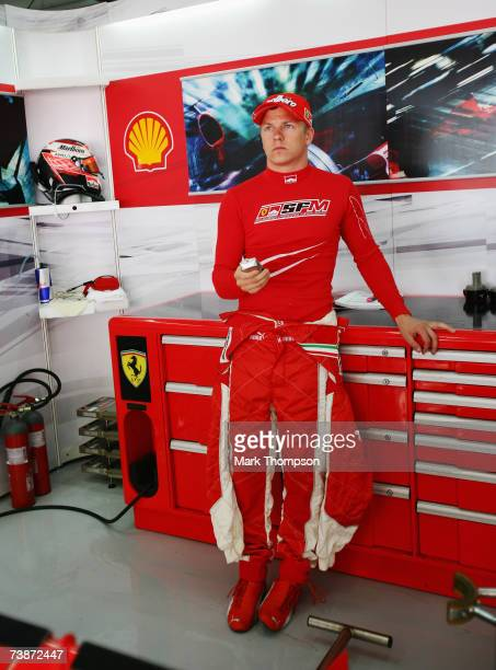 Kimi Raikkonen of Finland and Ferrari waits in the garage before driving during practice for the Bahrain Formula One Grand Prix at the Bahrain...