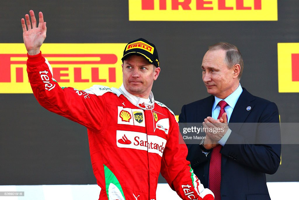 <a gi-track='captionPersonalityLinkClicked' href=/galleries/search?phrase=Kimi+Raikkonen&family=editorial&specificpeople=201904 ng-click='$event.stopPropagation()'>Kimi Raikkonen</a> of Finland and Ferrari walks out onto the podium, Russian President <a gi-track='captionPersonalityLinkClicked' href=/galleries/search?phrase=Vladimir+Putin&family=editorial&specificpeople=154896 ng-click='$event.stopPropagation()'>Vladimir Putin</a> applauds during the Formula One Grand Prix of Russia at Sochi Autodrom on May 1, 2016 in Sochi, Russia.