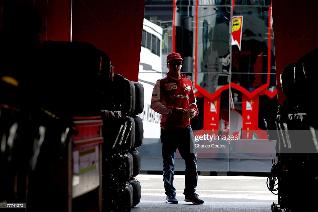 Kimi Raikkonen of Finland and Ferrari walks through the paddock during practice for the Formula One Grand Prix of Austria at Red Bull Ring on June 19...