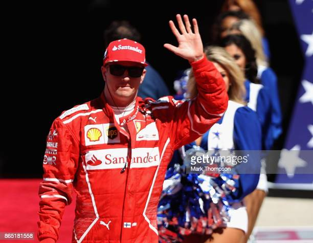 Kimi Raikkonen of Finland and Ferrari waves to the crowd before the United States Formula One Grand Prix at Circuit of The Americas on October 22...