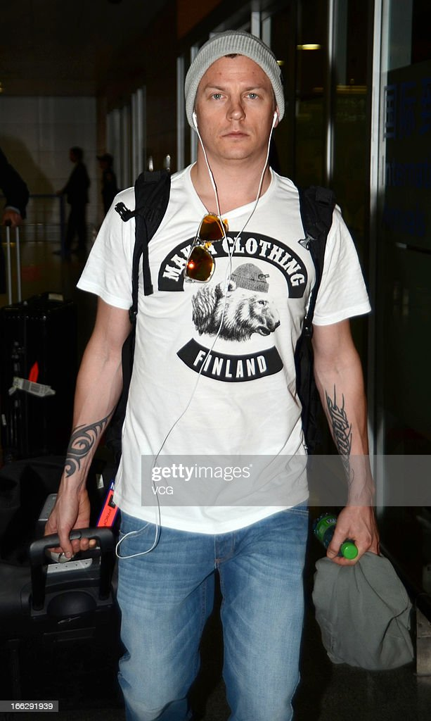 Kimi Raikkonen of Finland and Lotus arrives at Shanghai Pudong International Airport ahead of the Chinese F1 Grand Prix 2013, on April 11, 2013 in Shanghai, China.
