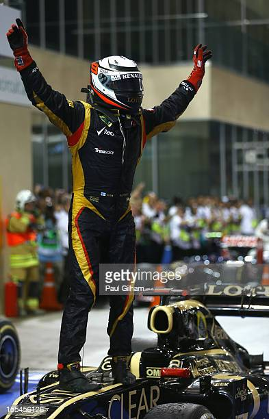 Kimi Raikkonen of Finland and Lotus celebrates in parc ferme after winning the Abu Dhabi Formula One Grand Prix at the Yas Marina Circuit on November...