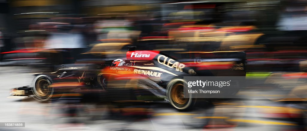 Kimi Raikkonen of Finland and Lotus drives in for a pitstop on his way to winning the Australian Formula One Grand Prix at the Albert Park Circuit on March 17, 2013 in Melbourne, Australia.