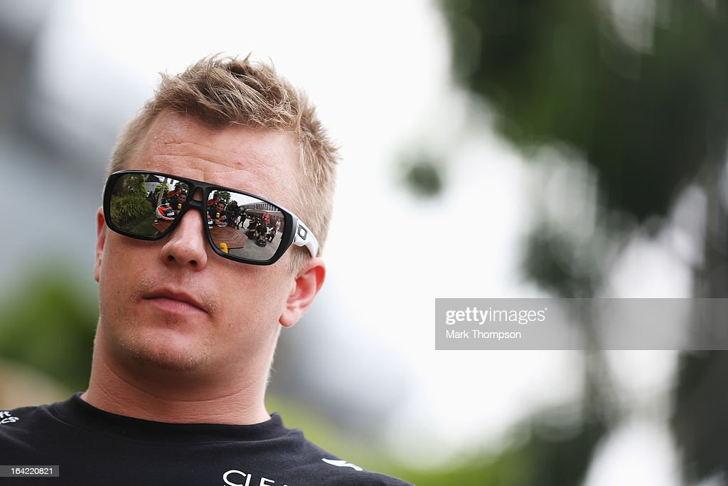 Kimi Raikkonen of Finland and Lotus is interviewed in the paddock during previews to the Malaysian Formula One Grand Prix at the Sepang Circuit on March 21, 2013 in Kuala Lumpur, Malaysia.