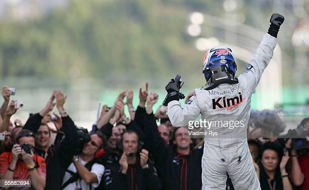 Kimi Raikkonen of Finland and McLaren Mercedes celebrates winning the F1 Grand Prix of Japan on October 9 2005 in Suzuka Japan