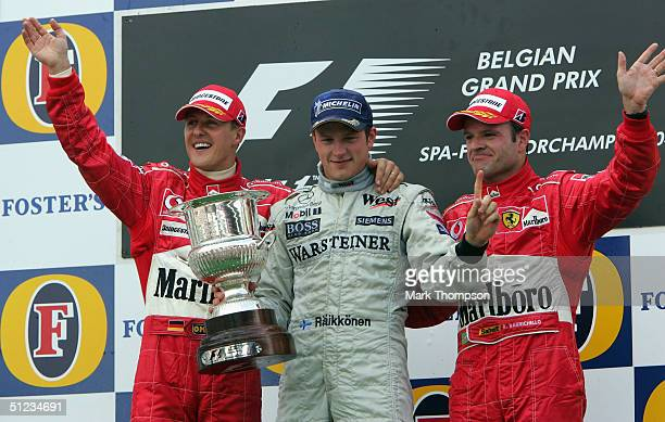 Kimi Raikkonen of Finland and McLaren Mercedes celebrates with Michael Schumacher of Germany and Ferrari and Rubens Barichello of Brazil and Ferrari...