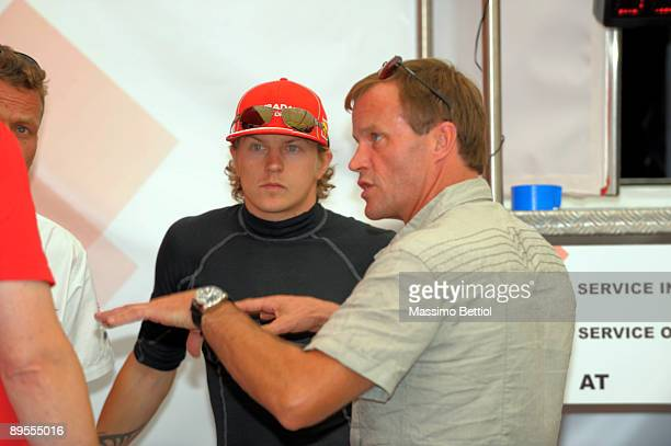 Kimi Raikkonen of Finland and Tommi Makinen of Finland in the service park during Leg 2 of the WRC Neste Oil Rally of Finland on August 01 2009 in...