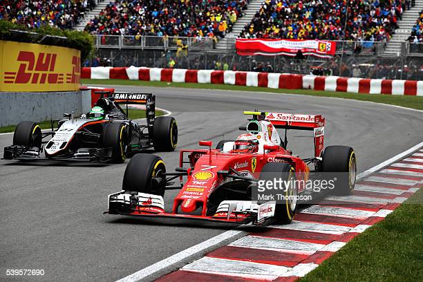 Kimi Raikkonen of Finland driving the Scuderia Ferrari SF16H Ferrari 059/5 turbo battles for position with Nico Hulkenberg of Germany driving the...