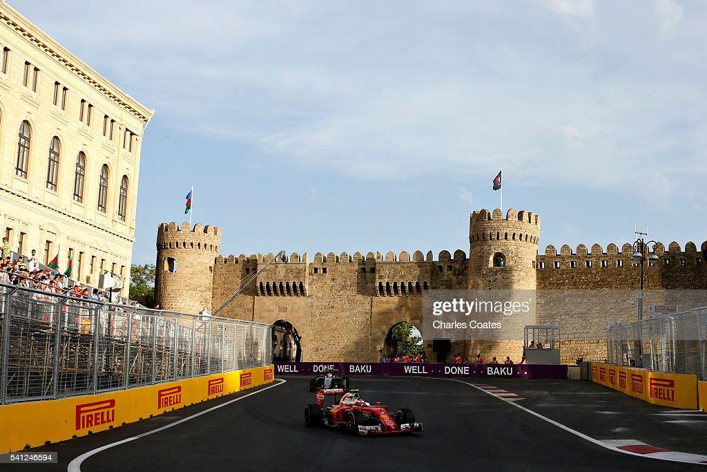 Kimi Raikkonen of Finland driving the (7) Scuderia Ferrari SF16-H Ferrari 059/5 turbo (Shell GP) and Sergio Perez of Mexico driving the (11) Sahara Force India F1 Team VJM09 Mercedes PU106C Hybrid turbo on track during the European Formula One Grand Prix at Baku City Circuit on June 19, 2016 in Baku, Azerbaijan.