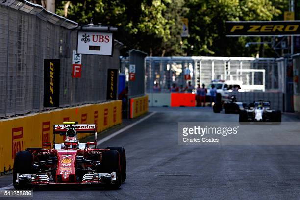 Kimi Raikkonen of Finland driving the Scuderia Ferrari SF16H Ferrari 059/5 turbo leads Felipe Massa of Brazil driving the Williams Martini Racing...